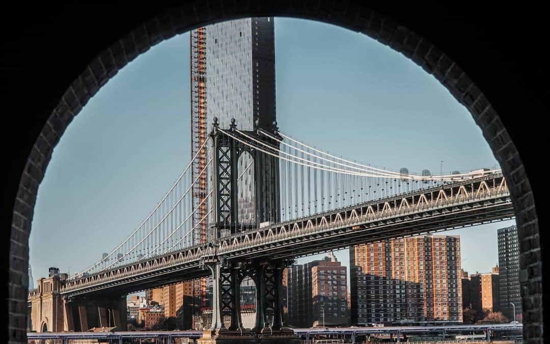 Image of a bridge and a city.