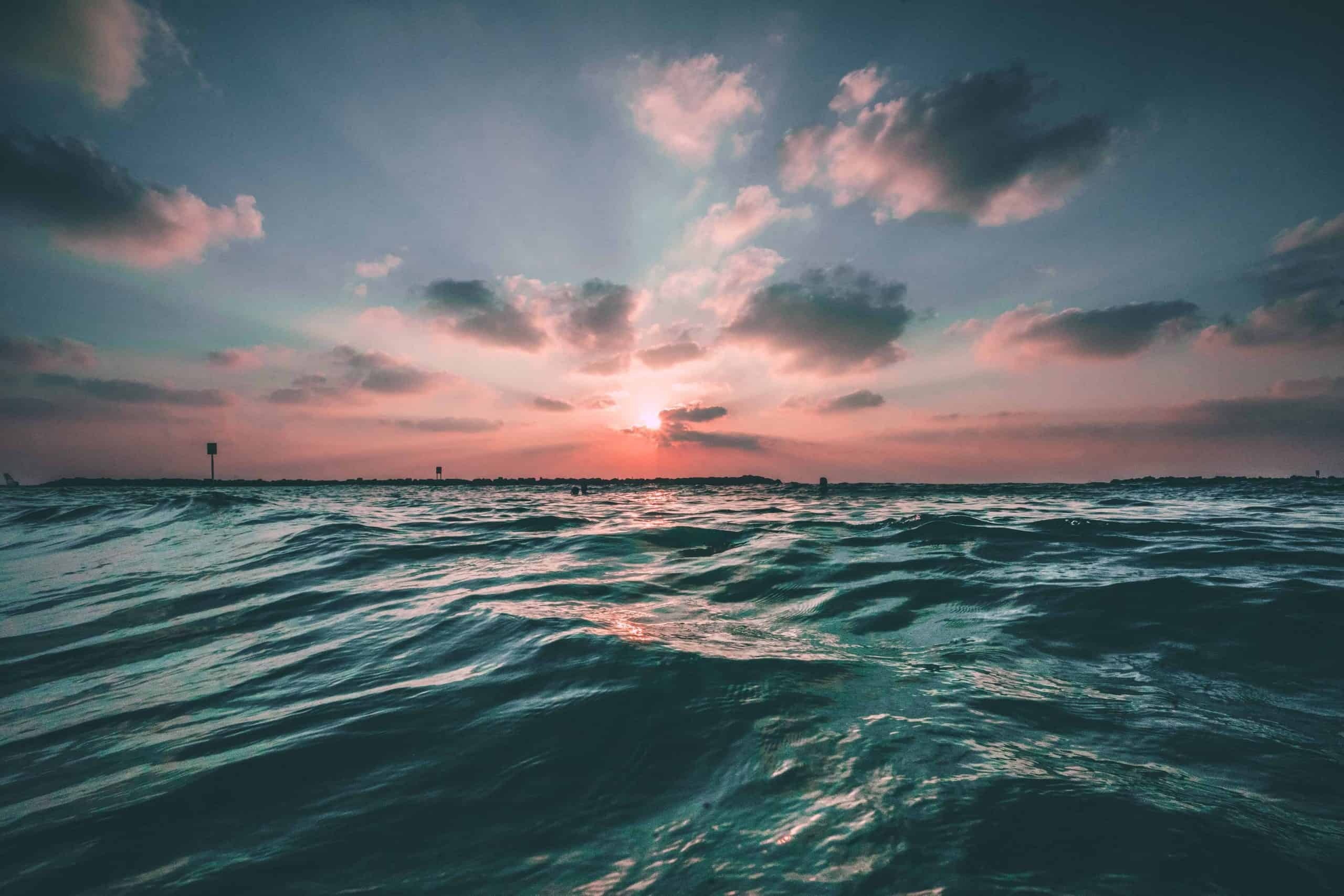 Ocean with a cloudy sunset.
